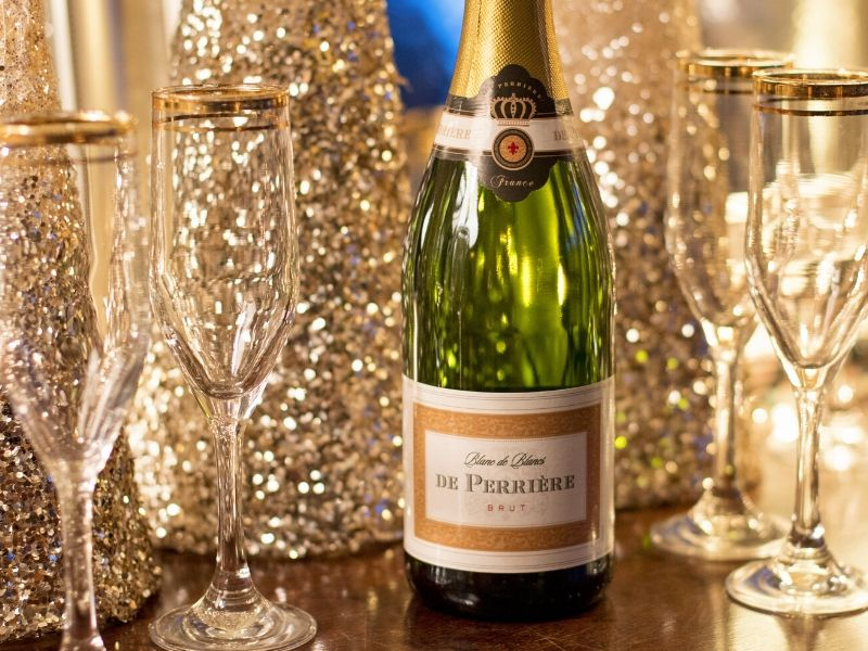 Bottle of champagne and flutes ready for a toast