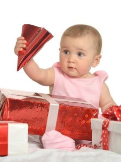 baby girl surrounded by gifts