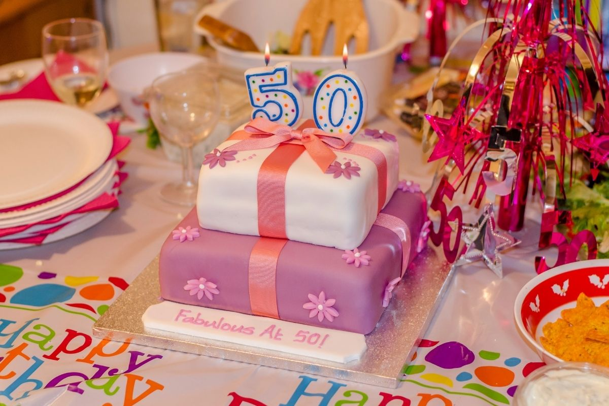 """50th birthday decorations, and cake that says """"fabulous at 50!"""""""
